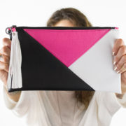 pink geometric vegan leather clutch